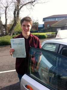 Robbie with his Practical Driving Test Pass Certificate outside Weston-super-Mare Driving Test Centre
