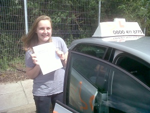 Annabel with her Practcal Driving Test Pass Certificate outside Taunton Driving Test Centre.