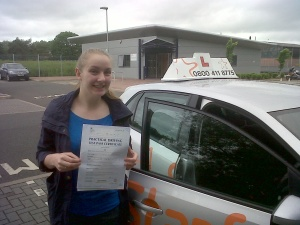 Daisy with her Practical Driving Test Pass Certificate outside Taunton Driving Test Centre.