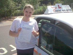 Evie with her Practical Driving Test Pass Certificate outside Taunton Driving Test Centre.