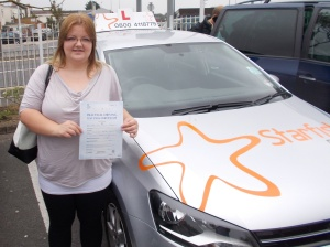 Larissa with her Practical Driving Test Pass Certificate somewhere in Weston-super-Mare