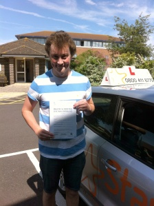 Ben with his Practical Driving Test Pass Certificate outside Weston-super-Mare Driving Test Centre
