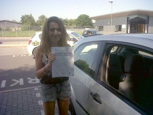 Georgie with her Pracitcal Driving Test Pass Certificate outside Taunton Driving Test Centre.