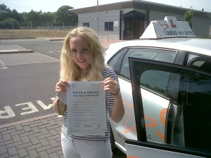 JoJo with her Practical Driving Test Pass Certificate outside Taunton Driving Test Centre.
