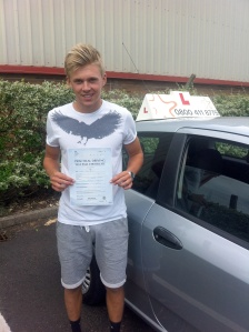 Kieran with his Practical Driving Test Pass Certificate outside Weston-super-Mare Driving Test Centre