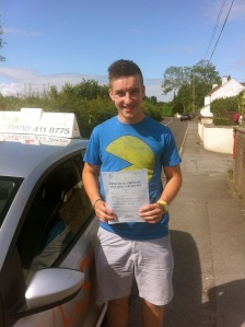 Sam with his Practical Driving Test Pass Certificate somewhere in Brent Knoll.