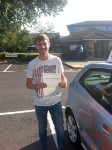 Oliver with his Practical Driving Test Pass Certificate outside Weston-super-Mare Driving Test Centre