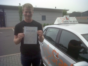 Ben with his Practical Driving Test Pass Certificate outside Taunton Driving Test Centre.