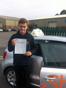 Jack with his Practical Driving Test Pass Certificate somewhere in Cheddar.