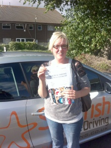 Loren with her Practical Test Pass Certificate outside Weston-super-mare Driving Test Centre.