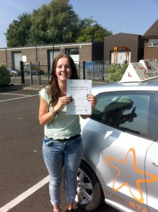 Sarah with her Practical Driving Test Pass Certificate outside Weston-Super-Mare Driving Test Centre