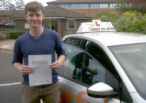 Ben with his Practical Driving Test Pass Certificate outside Weston Super Mare Driving Test Centre
