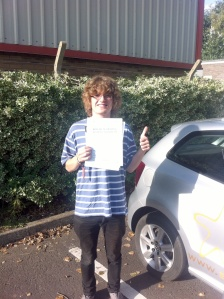 Charlie with his Practical Driving Test Pass Certificate outside Weston Super Mare Driving Test Centre.