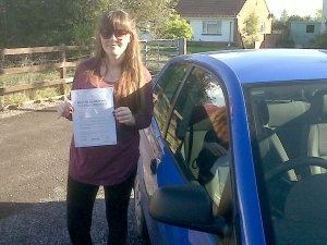 Jenna with her Practical Driving Test Pass Certificate somewhere in Mark.