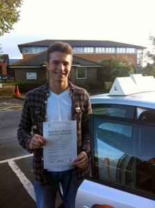 Kit with his Practical Driving Test Pass Certificate outside Weston Super Mare Driving Test Centre
