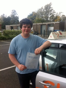 Owen with his Practical Driving Test Pass Certificate outside Weston-super-Mare Driving Test Centre