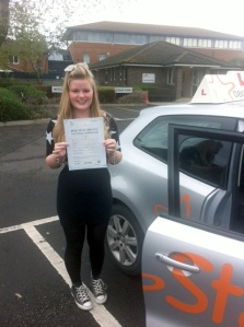 Clara with her Practical Driving Test Pass Certificate outside Weston-super-Mare Driving Test Centre