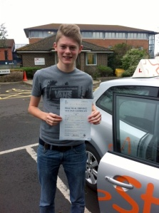 Adam with his Practical Driving Test Pass Certificate outside Weston-super-Mare Driving Test Centre