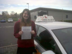 Lydia with her Practical Driving Test Pass Certificate outside Taunton Driving Test Centre
