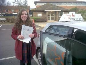Abby with her Practical Driving Test Pass Certificate outside Weston-super-mare Driving Test Centre.