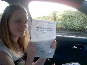 Jenifer with her Practical Driving Test Pass Certificate outside Weston-super-Mare Driving Test Centre