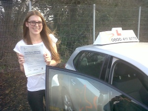 Megan with her Practical Driving Test Pass Certificate outside Taunton Driving Test Centre