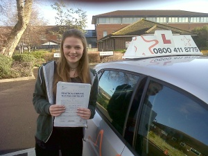 Rachel with her Practical Driving Test Pass Certificate outside Weston-super-mare Driving Test Centre