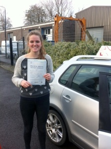 Shannon with her Practical Driving Test Pass Certificate outside Weston-super-mare Driving Test Centre.