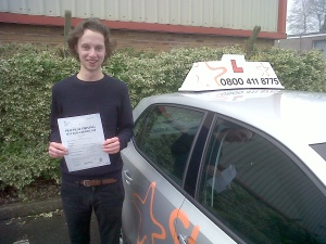Gabe with his Practical Driving Test Pass Certificate outside Weston-super-Mare Driving Test Centre.