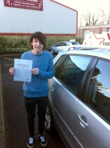 John with his Practical Driving Test Pass Certificate outside Weston-super-Mare Driving Test Centre