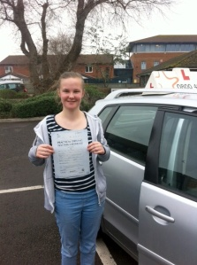 Kate with her Practical Driving Test Pass Certificate outside Weston-super-Mare Driving Test Centre