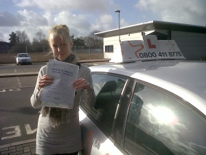 Lena with her Practical Driving Test Pass Certificate outside Taunton Driving Test Centre.