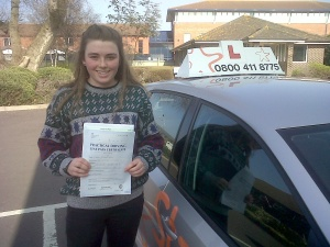 Holly with her Practical Driving Test Pass Certificate outside Weston-super-Mare Driving Test Centre.
