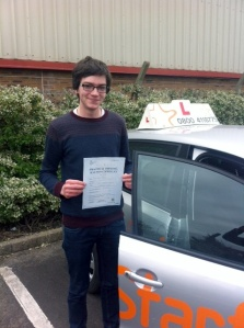 Jack with his Practical Driving Test Pass Certificate outside Weston-super-Mare Driving Test Centre