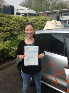 Jess with her Practical Driving Test Pass Certificate outside Weston-super-mare Driving Test Centre.