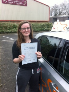 Lauren with her Practical Driving Test Pass Certificate outside Weston-super-Mare Driving Test Centre.