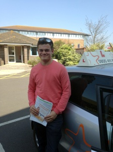 Sam with his Practical Driving Test Certificate outside Weston-Super-Mare Driving Test Centre.