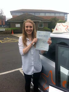 Sarah with her Practical Driving Test Pass Certificate outside Weston-super-Mare Driving Test Centre.