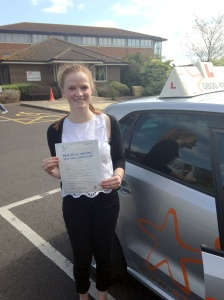 Bryony with her Practical Driving Test Pass Certificate outside Weston-super-Mare Driving Test Centre.