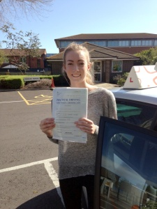 Sophie with her Practical Driving Test Pass Certificate outside Weston-super-Mare Driving Test Centre.