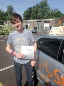 Charlie with his Practical Driving Test Pass Certificate outside Weston-super-mare Driving Test Centre