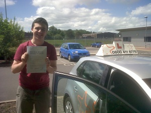 Douglas with his Practical Driving Test Pass Certificate outside Taunton Driving Test Centre