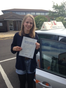 Robyn with her Practical Driving Test Pass Certificate outside Weston-Super-Mare Driving Test Centre.
