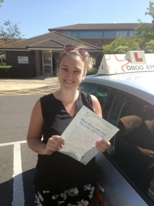 Sam with her Practical Driving Test Pass Certificate outside Weston-super-mare Driving Test Centre