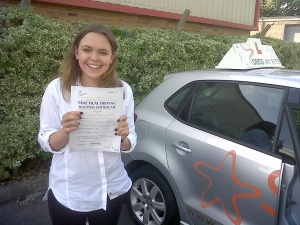 Chelsea with her Practical Driving Test Pass Certificate outside Weston-super-Mare Driving Test Centre