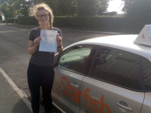 Lizzie with her Practical Driving Test Pass Certificate somewhere in Shipham.