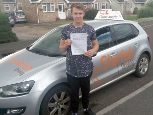 Sam with his Practical Driving Test Pass Certificate somewhere in Mark.