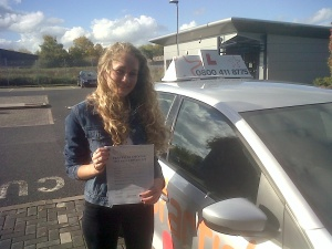 Poppy with her Practical Driving Test Pass Certificate outside Weston-super-Mare Driving Test Centre
