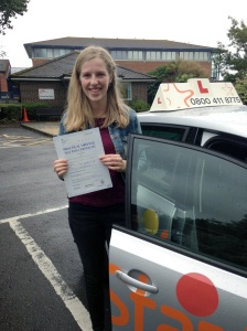 Rebecca with her Practical Driving Test Pass Certificate outside Weston-super-Mare Driving Test Centre.