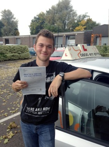 Steven with his Practical Driving Test Pass Certificate outside Weston-super-Mare Driving Test Centre